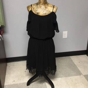 Cold shoulder dress in black with lace trim